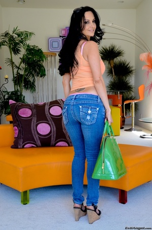 A brunette slut in jeans shows off her hot body for the camera - XXXonXXX - Pic 13