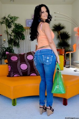 A brunette slut in jeans shows off her hot body for the camera - XXXonXXX - Pic 14