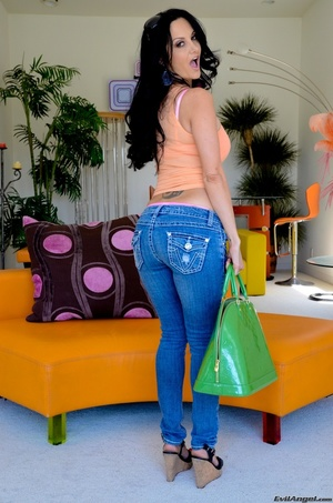 A brunette slut in jeans shows off her hot body for the camera - XXXonXXX - Pic 15