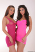 Beautiful brunette lesbians wearing tight pink dress in sexy stilettos