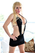 Glamorous, busty,raunchy blonde ladyboy willingly strips and parades her