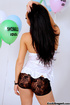 Innocent tattooed ladyboy in white top and shorts play with balloons while