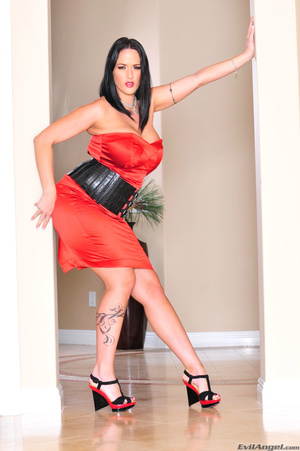 Classy brunette with arm tattoo in sexy dress and heels stands by the pillars and shows her sexy curves - XXXonXXX - Pic 3