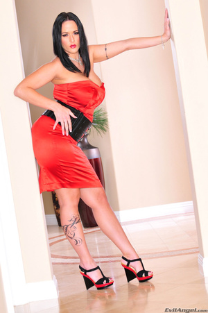 Classy brunette with arm tattoo in sexy dress and heels stands by the pillars and shows her sexy curves - XXXonXXX - Pic 4