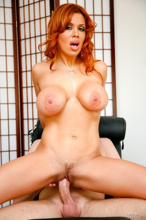 Foxy redhead in blue lingerie pose her smoking hot body in blue lingerie and silver and brown high heels then bares her large tits before she gets naked and lets her hunk boyfriend fuck her in different positions on a black couch before she sucks the spunk out of his large dick. - XXXonXXX - Pic 12