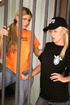 Jailer heads inside a cell to share a lesbian encounter with a ponytailed
