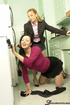 Two red-hot MILFs flirt and fondle in a small kitchen.