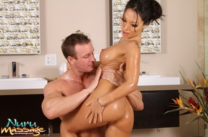 Hot Asian masseuse gives a guy a handjob and receives cum on her big tits - XXXonXXX - Pic 11