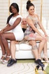 Black hottie in white dress and brunette in screenprint dress suck and
