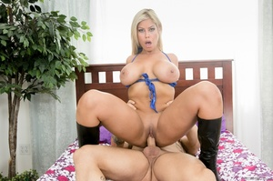Foxy blonde teases a muscular bald dude with her banging body in blue underwear and black boots before she pulls down her bra and releases her big racks then removes her panty and sucks his cock then lets him screw her in different styles on a purple, pink and white floral bed til he spunks in her mouth. - XXXonXXX - Pic 5