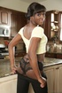 Hot chocolate girl in black pants posing in the kitchen with her lesbian