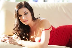 Posing on a couch from a blue-eyed, busty lady in red - XXXonXXX - Pic 1