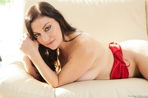 Posing on a couch from a blue-eyed, busty lady in red - XXXonXXX - Pic 7