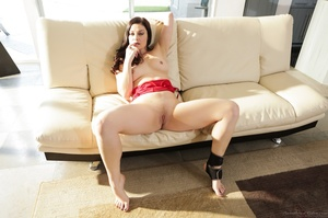 Posing on a couch from a blue-eyed, busty lady in red - XXXonXXX - Pic 12
