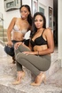 Topless posing from two exotic, dark-skinned lesbians