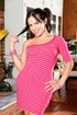 Black haired tranny with pigtails in pink dress looking so playful while