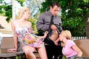 two blondes blowing guy