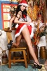 This brunette in Christmas outfit strips to get into the holiday spirit