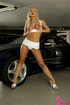 Stunning blonde takes all of her clothes in front of an expensive car