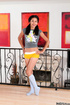 Pigtailed teen in grey top and blue socks took off yellow shorts and posing