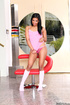 Black babe in pink top and white socks teasing on the red chair and exposing