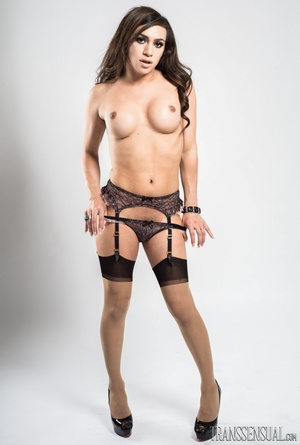 Sultry shemale in a full black lingerie poses to show her curves - XXXonXXX - Pic 3