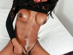 Ebony babe in black strips and plays with her - XXXonXXX - Pic 15
