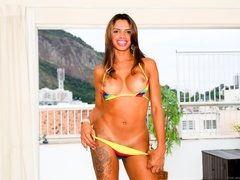 Tanned brunette in bikini shows off her cock by - XXXonXXX - Pic 3