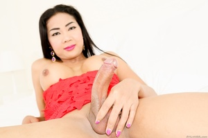 Perky Asian teases her cock under her red dress in the bed. - XXXonXXX - Pic 10