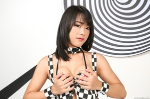 Petite Asian in checkered clothes shows off her hard cock in bed. - XXXonXXX - Pic 2