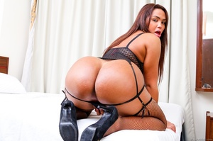 Voluptuous trans in black likes to spread her ass and stroke her dick. - XXXonXXX - Pic 7