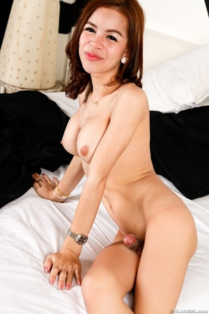 Slender transsexual in black likes to show her tits after a striptease. - XXXonXXX - Pic 9