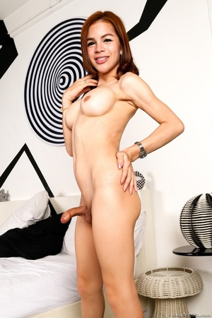 Slender transsexual in black likes to show her tits after a striptease. - XXXonXXX - Pic 13