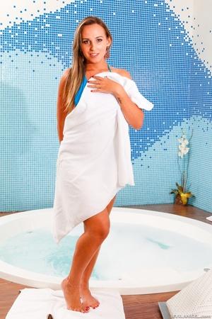 Tranny in blue bikini teases her curves in the hot tub. - XXXonXXX - Pic 1
