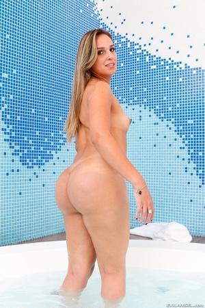 Tranny in blue bikini teases her curves in the hot tub. - XXXonXXX - Pic 14