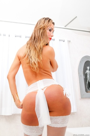 Big booty blonde in white stockings enjoys holding her hard cock. - XXXonXXX - Pic 2
