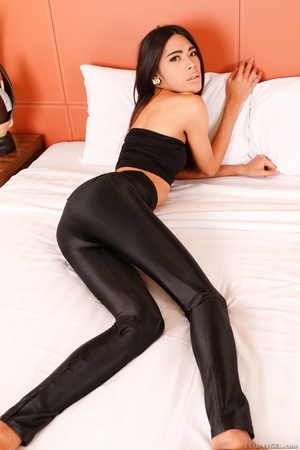 Hot tranny in black lowers her pants and teases her ass in bed. - XXXonXXX - Pic 4