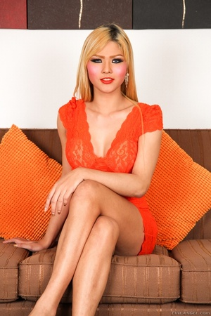 Blonde in orange strips naked and shows her curves on the sofa. - XXXonXXX - Pic 1