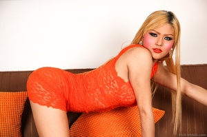 Blonde in orange strips naked and shows her curves on the sofa. - XXXonXXX - Pic 4