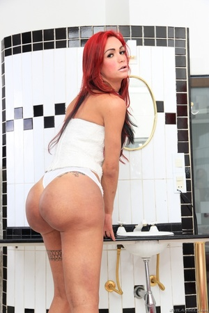 Redhead in white shows off her round ass in the bathroom. - XXXonXXX - Pic 1