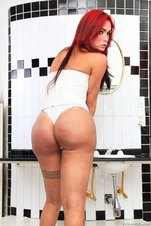 Redhead in white shows off her round ass in the bathroom. - XXXonXXX - Pic 2