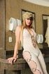 Blonde in white bodysuit strips and jerks off for fun.