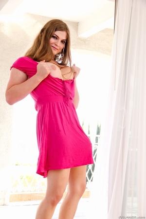 Brunette in pink dress grabs her cock on the bedroom floor. - XXXonXXX - Pic 13