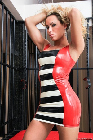 Sexy babe in latex dress shows off her curves in a cage. - XXXonXXX - Pic 7