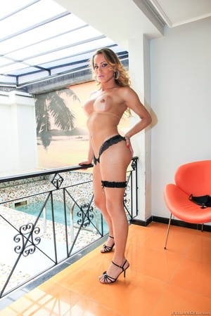 Blonde trans in lingerie strips by the pool and gets her cock hard. - XXXonXXX - Pic 2
