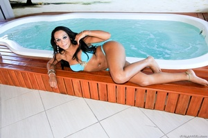 Voluptuous brunette babe in blue bikini teases by the jacuzzi. - XXXonXXX - Pic 4