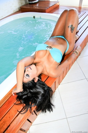 Voluptuous brunette babe in blue bikini teases by the jacuzzi. - XXXonXXX - Pic 7