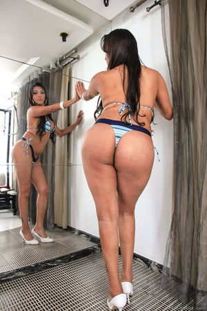 Seductive brunette in blue bikini teases her curves by the mirror. - XXXonXXX - Pic 8
