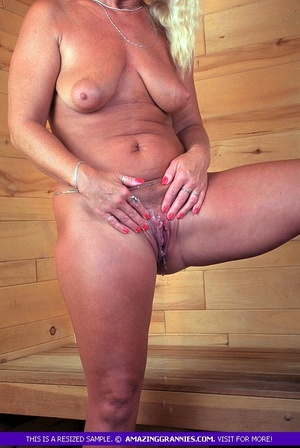 Fat granny shows her lusty boobs as she pose topless then pulls down blue panty and reveals her nasty pussy in different poses. - XXXonXXX - Pic 8