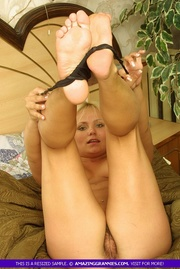 blonde mature chick displays